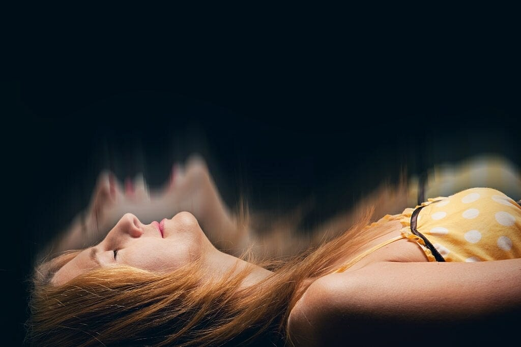 A concept image of a sleeping woman having a nightmare.