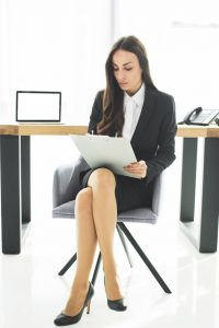 Sitting in a cross-legged position